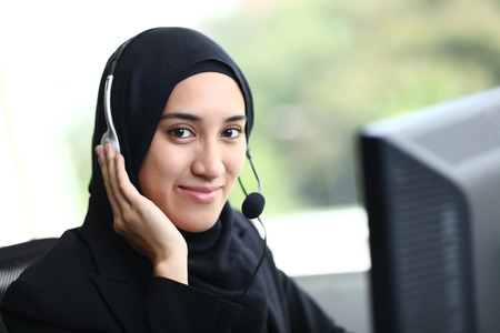 Photo for Beautiful muslim business woman smiling at camera - Royalty Free Image