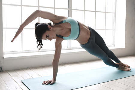 Foto de Young Woman Doing Yoga Pose Exercise Healthy Lifestyle - Imagen libre de derechos