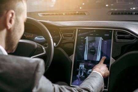 Photo pour Man transportation by modern eco car control panel - image libre de droit