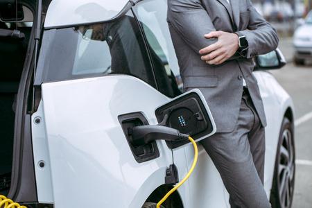 Foto de Man transportation by modern eco car charge energy - Imagen libre de derechos