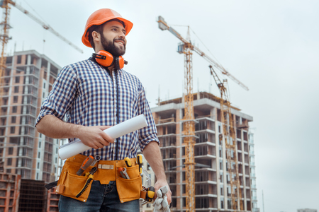 Foto de Male work building construction engineering occupation holding blueprint - Imagen libre de derechos