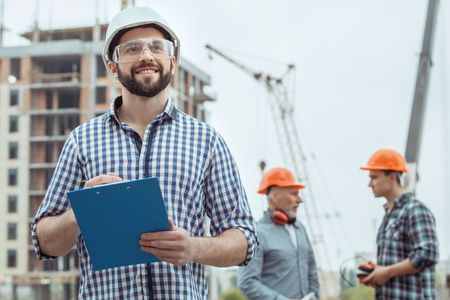 Foto de Male work building construction engineering occupation project - Imagen libre de derechos