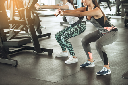 Photo for Young women exercise together in the gym - Royalty Free Image