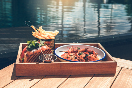 Photo for Food meal near the swimming pool no people - Royalty Free Image