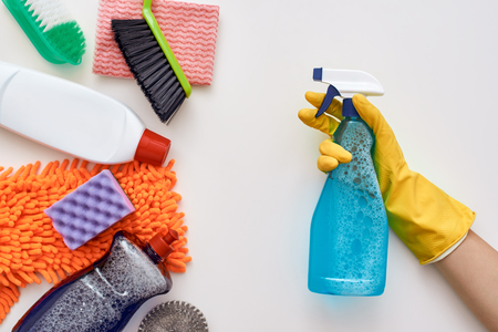 Foto de Keep cleaning. Spray bottle attacked other items isolated - Imagen libre de derechos
