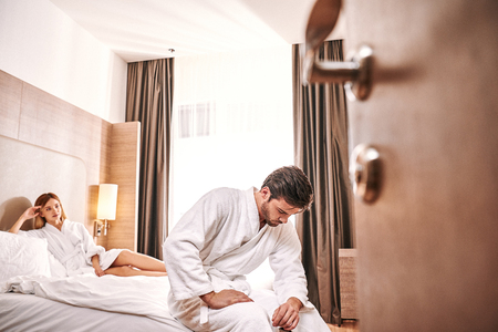 Foto de Weakness worried man in hotel room. Man cant make sex with his woman - Imagen libre de derechos