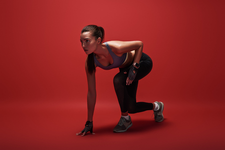 Photo for Getting ready. Attractive young sportswoman is ready to run - Royalty Free Image