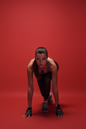 Photo for Ready steady go! Attractive young sportswoman is ready to run - Royalty Free Image