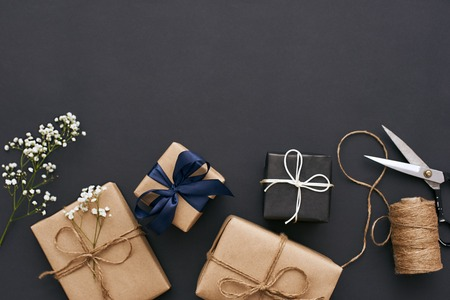 Photo for Preparing for holidays. Handmade gift boxes with beautiful decoration for friends - Royalty Free Image