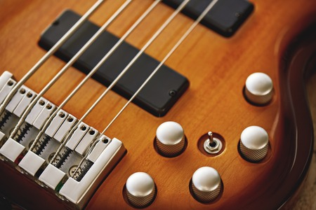 Photo for Parts of Electric guitar. Close up view of electric guitar body with volume and tone control knobs - Royalty Free Image