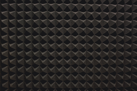 Foto de Strong protection from loud music. Close up view of a grey soundproof coverage for a recording studio - Imagen libre de derechos