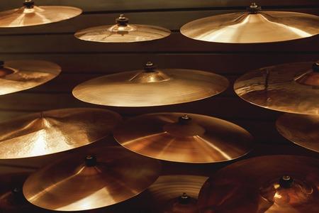 Foto de Visiting musical instrument store. Different types of drum cymbals for your ideal drum set. Music concept. - Imagen libre de derechos