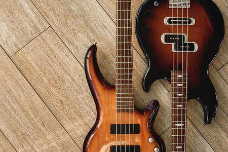 Photo for Harmony Guitars. Top view of the electric guitars lying close to each other against of the wooden floor. Music concept. - Royalty Free Image