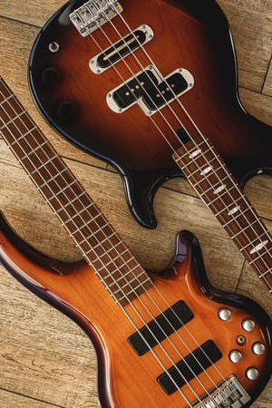 Photo for Perfect sound. Top view of the different electric guitars lying close to each other against of the wooden floor. Music concept. - Royalty Free Image