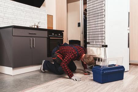 Photo pour Ups, You have a trouble. Young Male Technician Checking Refrigerator - image libre de droit