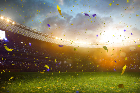 Photo pour Evening stadium arena soccer field championship win. Confetti and tinsel . Yellow toning - image libre de droit