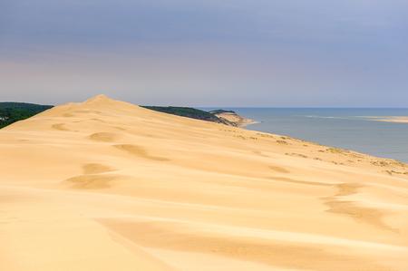 Photo pour Dune of Pilat (Grande Dune du Pilat), the tallest sand dune in Europe. And the Atlantic Ocean. - image libre de droit