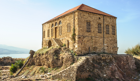Photo for Traditional Lebanese house over the Mediterranean sea, Byblos, Lebanon. The house is within the antiquities complex and illustrates the modern ground level with respect to excavations - Royalty Free Image