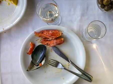 Photo for Image of empty plates with remnants of food after lunch - Royalty Free Image