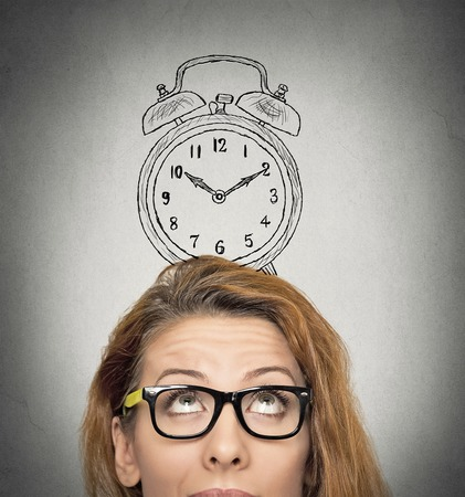 Photo pour closeup headshot young business woman with alarm clock drawing sketch above her head, isolated grey wall background. Human face expressions, emotions. Time, punctuality, busy schedule concept - image libre de droit