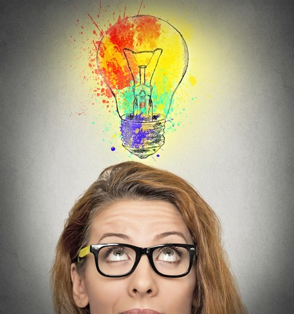 Photo pour woman having brilliant idea colorful lightbulb above head, isolated grey wall background. Human face expressions, emotions, feelings. Creativity, imagination, dynamism, intelligence concept - image libre de droit