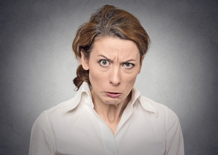 portrait angry woman on grey background