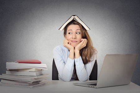 Foto de Closeup portrait annoyed woman  fed up of studying, isolated grey blackboard  background.  - Imagen libre de derechos
