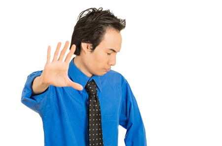 Foto de Closeup portrait young grumpy man with bad attitude giving talk to hand gesture with palm outward isolated white background. Negative emotion facial expression feeling body language life perception - Imagen libre de derechos