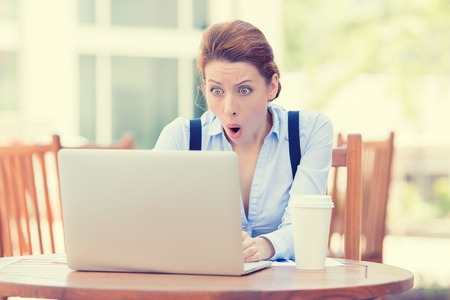 Photo for Shocked young business woman using laptop looking at computer screen blown away in stupor sitting outside corporate office. Human face expression, emotion, feeling, perception, body language, reaction - Royalty Free Image