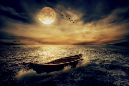 Photo pour Boat drifting away from past in middle of ocean after storm without course on moonlight sky night skyline clouds background. Conceptual nature landscape screen saver. Life saver  future hope concept - image libre de droit