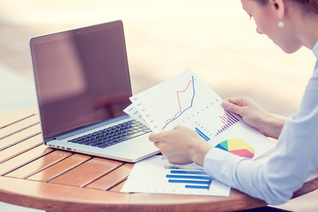 Foto de woman investment consultant analyzing company annual financial report balance sheet statement working with documents graphs. Stock market, office, tax, education concept. Hands with charts papers - Imagen libre de derechos