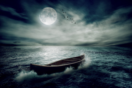 Photo pour Boat drifting away in middle ocean after storm without course moonlight sky night skyline clouds background. Nature landscape screen saver. Life hope concept. Elements of this image furnished by NASA - image libre de droit