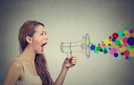 Photo pour Portrait angry screaming young woman holding megaphone isolated on grey wall background. Negative face expression emotion feelings. Propaganda, breaking news, power, social media communication concept - image libre de droit