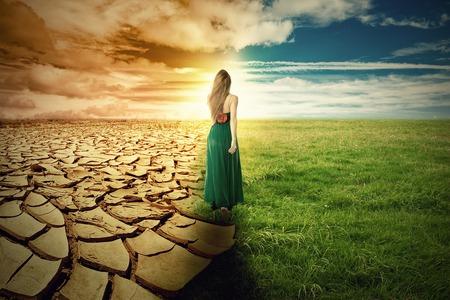 Foto de A Climate Change Concept Image. Landscape of a green grass and extreme dry drought land - Imagen libre de derechos