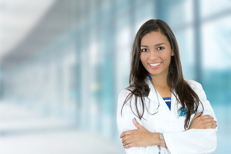 Photo for Portrait confident young female doctor medical professional standing isolated on hospital clinic hallway windows background. Positive face expression - Royalty Free Image