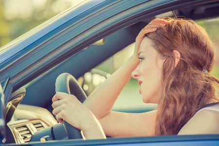 Foto de Side view window portrait displeased young stressed angry pissed off woman driving car annoyed by heavy traffic. Emotional intelligence concept. Negative human face expression - Imagen libre de derechos