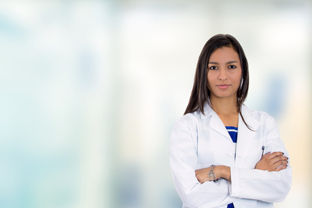 Photo pour Portrait confident young female doctor medical professional standing in corridor isolated on hospital clinic hallway windows background. Positive face expression - image libre de droit