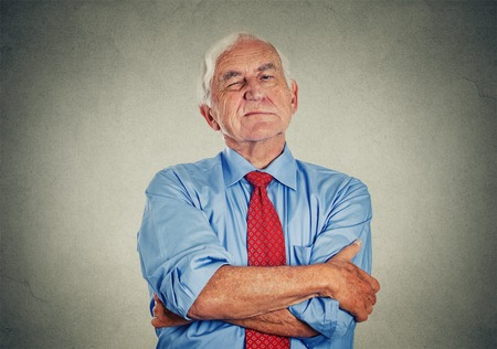 Photo for Portrait of unhappy grumpy pissed off senior mature man isolated on gray wall background. Negative human emotions, face expression feelings - Royalty Free Image