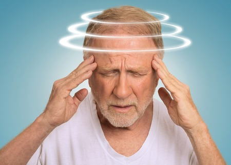 Photo pour Headshot senior man with vertigo. Elderly male patient suffering from dizziness isolated on light blue background - image libre de droit