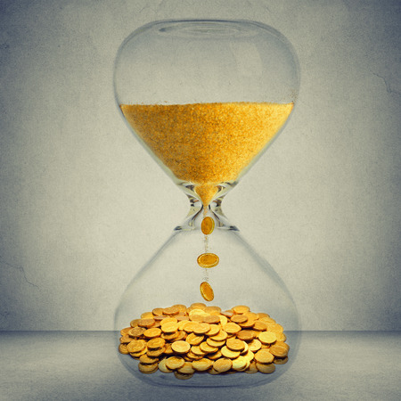 Photo for Time is money financial opportunity concept. Sand clock with gold dust and coins isolated on gray wall background - Royalty Free Image
