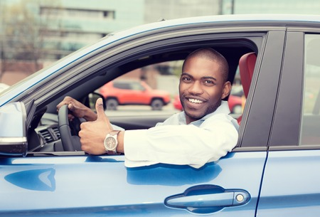 Photo pour Car side window. Man driver happy smiling showing thumbs up driving sport blue car isolated outside parking lot background. Handsome young man excited about his new vehicle. Positive face expression - image libre de droit