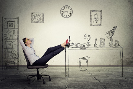 Photo pour young businesswoman relaxing sitting in the office - image libre de droit