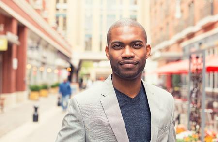 Foto de Headshot portrait of young man smiling isolated on outside outdoors background. - Imagen libre de derechos