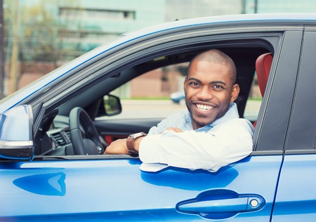 Photo pour Closeup portrait happy smiling young man buyer sitting in his new car excited ready for trip isolated outside dealer dealership lot office. Personal transportation auto purchase concept - image libre de droit