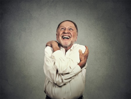 Photo pour Closeup portrait confident smiling man holding hugging himself isolated on grey wall background. - image libre de droit