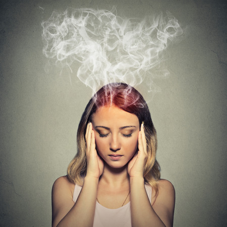 Photo pour Portrait young stressed woman thinking too hard steam coming out up of head isolated on grey wall background.  - image libre de droit