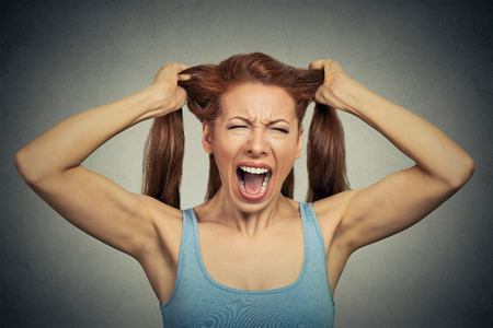 Photo for Portrait of a very angry woman screaming acting out - Royalty Free Image