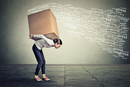 Photo for Stressed woman carrying on her back shoulders large box - Royalty Free Image
