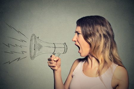 Photo for Portrait angry screaming young woman holding megaphone isolated on grey wall background. Negative face expression emotion feelings. Propaganda, breaking news, power, social media communication concept - Royalty Free Image
