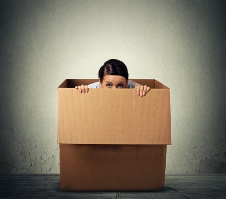Photo for Young woman hiding in a carton box - Royalty Free Image